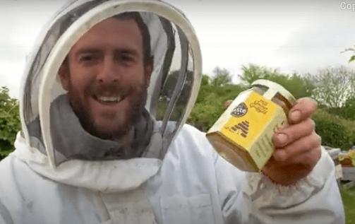 bee farmer with honey