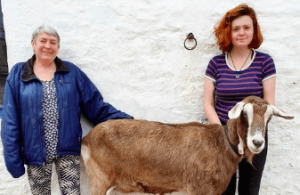 Juanita Wilson MBE and her new staff member Beth Black, and a goat