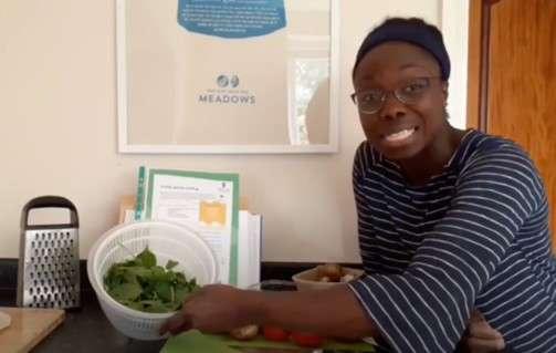 woman presenting food